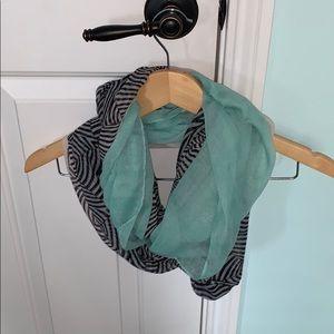 A blue, white, and zebra print layered scarf